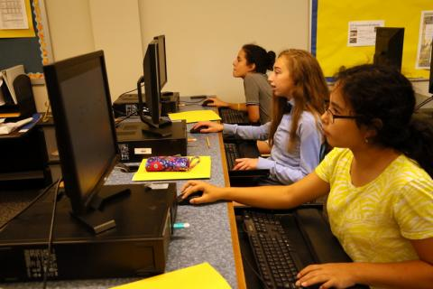 From front right, Nancy Chung, Ava Schwartz, and Eliza Roth - students in Continuing Education's Graphics Camp - worked on projects on computers at Newtown High School on Wednesday, July 6.  (Bee Photo, Hallabeck)