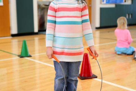 Sandy Hook Elementary School kindergartner Aviva Fung pauses between jumping rope at her school on March 23. (Bee Photo, Hallabeck)