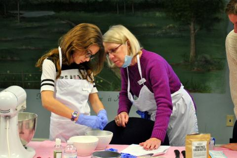 """Beverly Amblo, left, works with Cyrenius H. Booth Library clerk Terry Tortora to add lavender essential oil to a cocoa butter and baking soda mix for bath """"bombs"""" on March 22 at the library's """"Bath Bombs And Sugar Scrubs"""" event.  (Bee Photo, Hallabeck)"""