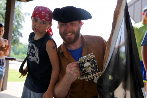 Newtown Parks & Recreation day camper Andrew Moran and Site Director Chris Browne were among those who dressed up for Pirate Day on July 21 at Treadwell Memorial Park. (Bee Photo, Hallabeck)