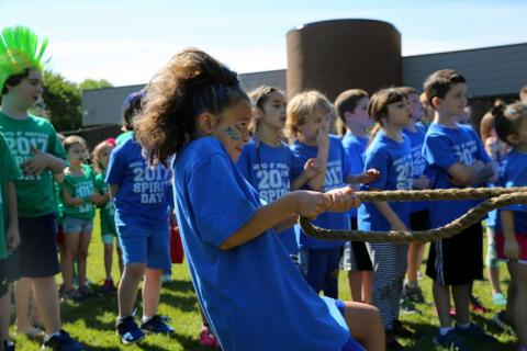 Head O' Meadow Elementary School fourth grade student Medina Selmani helps pull her team to victory in a spirited rope tug that kicked off the school's Spirit Day on Friday, June 2.  (Bee file photo)