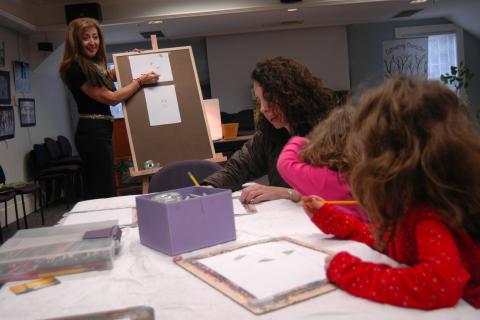 "Regina Rayzvikh, far left, with Regina's Art Center of Brooklyn, N.Y., offered a ""Drawing School for a Day"" lesson on Thursday, April 11, at the C.H. Booth Library. The event was both sponsored and presented by Regina's Art…"