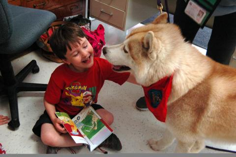 Hawley Elementary School kindergartener Henry Baraw met Ringo, a therapy dog that visited the school on Wednesday, May 13, as part of a visit to the school by Charlotte's Litter volunteers.