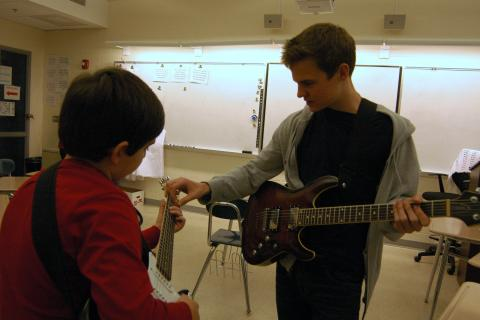 Newtown High School sophomore Dawson Goodrich, right, helped Sandy Hook School fourth grader Michael Spanedda during the first day of this year's High school Elementary Musicianship Mentoring Association (HEMMA) program.