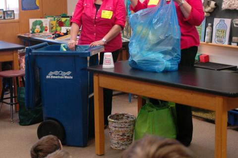 "Housatonic Resources Recovery Authority (HRRA) Assistant Director Jen Iannucci, left, and Director Cheryl Reedy, right, visited with students at Middle Gate Elementary School on Monday, April 22, and discussed ways students can ""reduce, reuse,…"