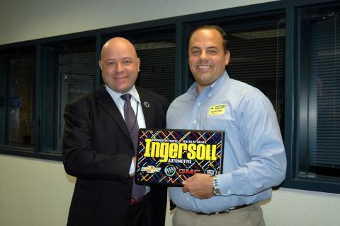 Todd Ingersoll, right, president of Ingersoll Automotive of Danbury, met with Newtown High School Principal Charles Dumais on Monday, November 18, to donate ten laptops to the high school from his dealership.