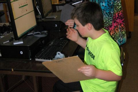 Brother and sister AJ and Grace Zatulskis worked in Middle Gate Elementary School's library/media center to complete a scavenger hunt on Tuesday, March 31, as part of the school's Special Night, which highlighted lessons offered in the…