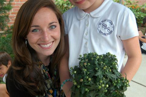 St Rose of Lima School third grader Ryann Heim and St Rose of Lima second grade teacher Erin Yost helped Ms Yost's class plant mums at the school on Friday, September 13, to replace flowers planted by Ryan in honor of the 26 victims at Sandy…