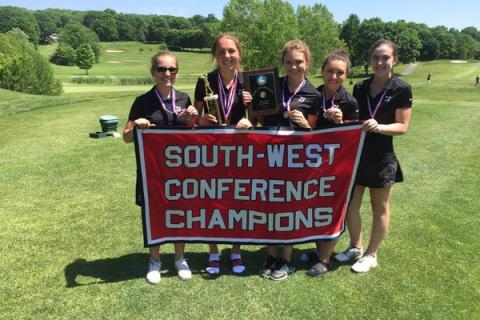 Members of the Nighthawks celebrate their second consecutive SWC championship. Pictured are, from left: Sydney Marino, Sarah Houle, Hannah Logan, Casey Muckell, and Liz Wesigerber.
