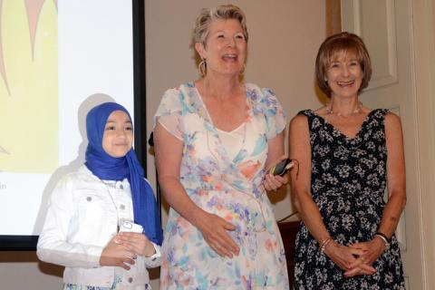 Co-authors Mariam Azeez, Terry Murphy, and Deborah Clarke, from left, take a bow at the conclusion of a launch event for their children's book Soulful Sydney Explores Diversity in the Alexandria Room at Edmond Town Hall on July 15.  (Bee Photos, Voket)