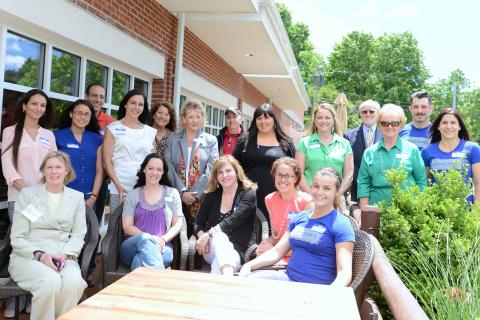 Representing many of the businesses awarded in the Best of Fairfield County Reader's Choice Poll conducted by CTNow.com, and several town officials, from left, seated, are Director of Economic and Community Development Elizabeth Stocker, Kathy…