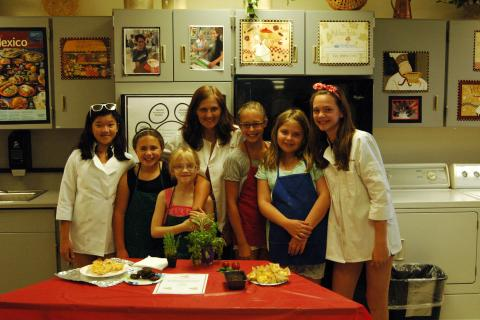 Sharon Martovich, fourth from left, posed for a picture with her students at the End of Cooking Camp Party held on Friday, July 18.