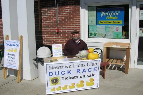 Dan O'Grady, a new member of Newtown Lions Club, recently sold Duck Race tickets outside Newtown Hardware Store. Tickets are still $5 each, and this year's top prize is $2,000.