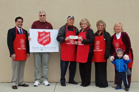 Newtown Lions Club continued its tradition of kicking off the Salvation Army bell ringing program with a donation to the local service unit on November 26. From left is Glen Nanavaty, president of the Newtown-Bethel Service Unit of the Salvation…