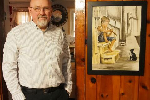 """Artist David Maier with his work """"Audience of One.""""  (Newtown Cultural Arts Commission photo)"""