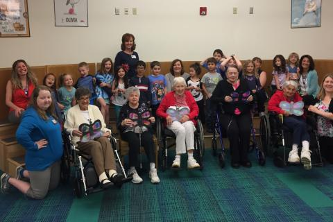 Kindergarten students at Hawley School, as well as their teachers and other faculty members, welcomed a group of Masonicare at Newtown residents to the Church Hill Road elementary school for an intergenerational program last month.