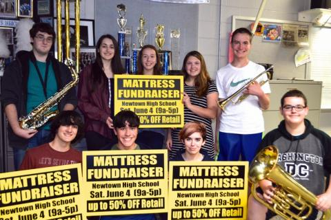 The NHS Marching Band & Guard is hosting a fundraiser at the school Saturday, June 4. Students pictured in the front row from left are David Romano, Dom Pasquarella, Avan Sheridan, and Trevor Merrick.  Standing from left are Ian Klepacki, Clare…