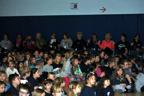 "Students, staff, and parents join together in singing ""Nothing More"" at the end of the Hawley School Kindness Assembly."