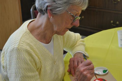 Newtown resident Marlene Whitney painted a Hearts of Hope ceramic heart on Thursday, May 9, at a Newtown Senior Center workshop to support the project that sent Hearts of Hope to Boston, following the April 15 Boston Marathon bombings.
