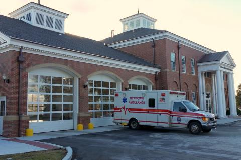 One of the three Newtown Volunteer Ambulance Corps ambulances sits ready for action outside the corps headquarters on the Fairfield Hills campus. As call volume continues to increase with 2,482 responses for emergency medical treatment logged in…