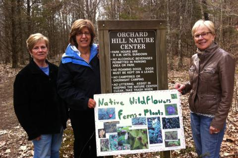 From left are Town & Country Garden Club members Judy Beers, Josie Schmidt, and Diana Johnson, members of the garden club's committee responsible for preparing Orchard Hill Nature Center for the upcoming guided tours and walks, Sunday, May 5.