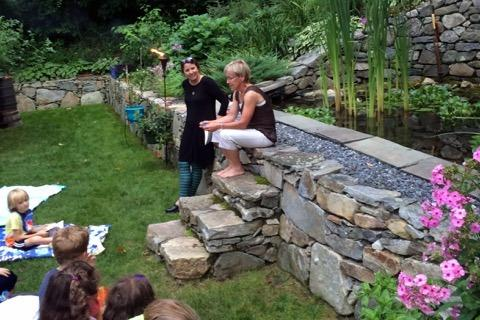 Newtown Poetry Project co-founders Lea Attanasio, center right, and Carol Ann Davis welcomed participants at a garden party on Wednesday, August 12, which celebrated the launch of a collection of poetry titled Hello World: The Newtown Poetry Project 2015.