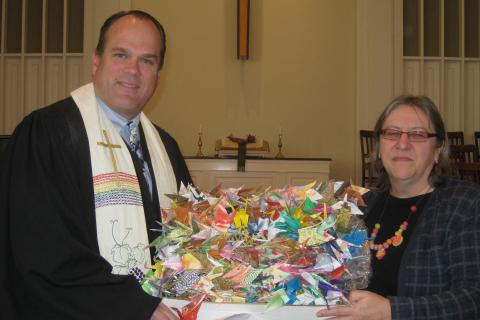 Newtown Congregational Church Senior Pastor Matt Crebbin, with NCC member Diane Ciba, who on May 9 hand delivered 1,000 origami peace cranes to the Old South Church in Boston.