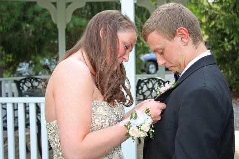 Erica Benoit pinned a boutonniere and Michael Gallatin.