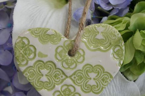 Small clay hearts created by Maryland artist Laurel Boyd are being offered for sale as part of a fundraiser for Newtown Lions Club's Sandy Hook Elementary Fund. The 2¾ by 2¾-inch ornaments are $10 each.