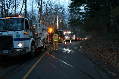 The section of Castle Hill Road near the house fire was closed to traffic for several hours as firefighters worked at the scene.