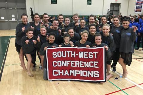 Members of Newtown High School's dance team celebrate their conference championships at New Milford High on January 30.