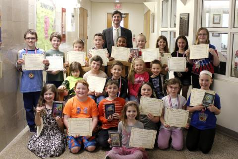 Middle Gate PTA Reflections participants present on March 14 pose for a picture with Principal Christopher Geissler. Standing in front is Ella Grace Renak; from left, second row are Maya Raslan, Marty Dunn, Lukas Durrwachter, Mary Guion, Katherine…