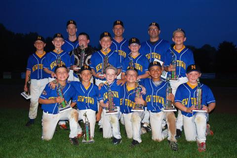 Members of the Wildcats celebrate their Cal Ripken district championship.