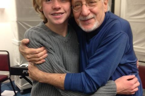 "Newtown student James Barden, left, gets a hug from legendary folk musician Peter Yarrow, Sunday, November 23, at the ""Within Our Reach"" concert."