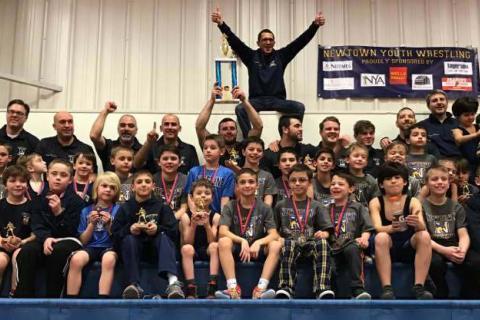 Members of Newtown's elementary team celebrate their championship. (Chris Stites photo)