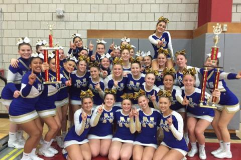 Newtown High's cheerleaders celebrate their triumph at the Connecticut Classic Cheer Competition.