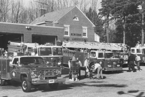 A photo dated November 1987 shows the trucks and headquarters for Newtown Hook & Ladder Co. #1 in its former location behind Edmond Town Hall. The fire company recently relocated to a brand-new facility at 12 Church Hill Road.