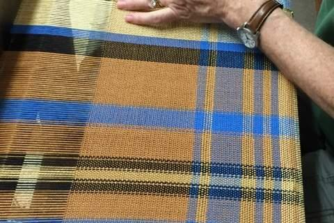 A plain weave plaid shawl being hemstitched on a loom by Peggy Murphy of Newtown. Projects like this will be showcased during the Newtown Weaving open house on December 3.  (Jennifer Rogers photo)