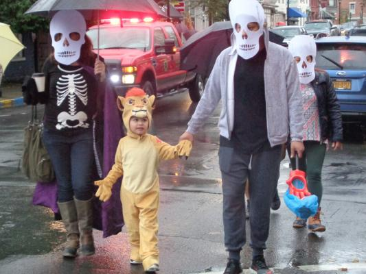 daniel zuckermancolumbia greene media a family dressed up as skeletons and simba from the lion king walk down warren street