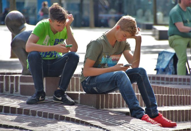 Teen boys using phones
