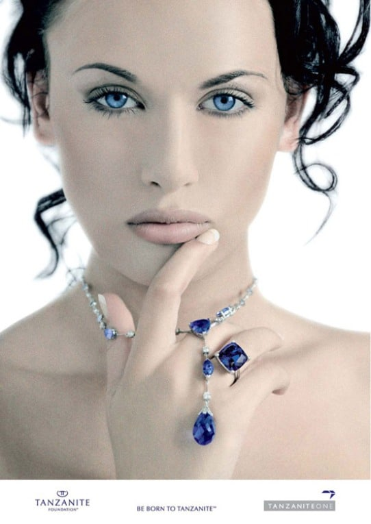 A press release photo from the TanzaniteOne Mining Group. A model wearing a tanzanite necklace pendant and ring