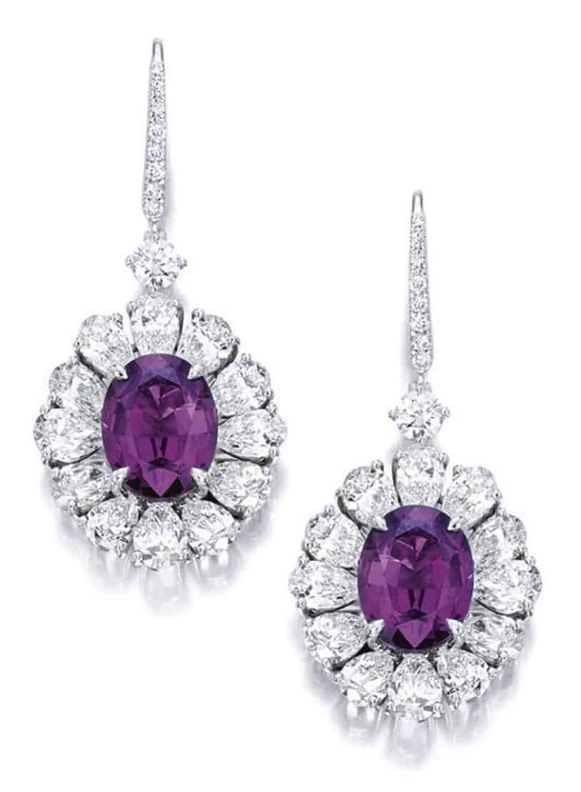 Lot 1758 - Pair of Alexandrite and Diamond Pendent Earrings as seen in incandescent light