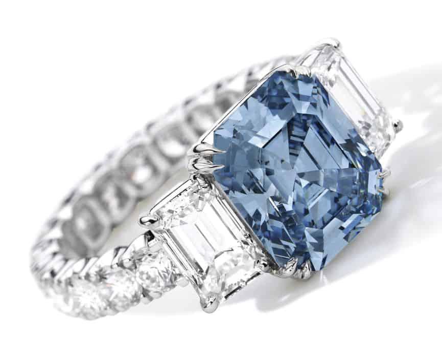 Lot 1784- Very Fine Fancy Intense Blue Diamond and Diamond Ring.