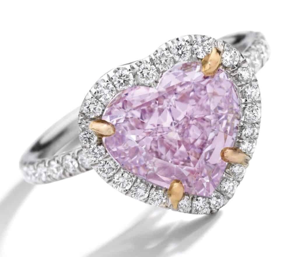 Lot 1786 - Fancy Intense Purple-Pink Diamond and Diamond Ring