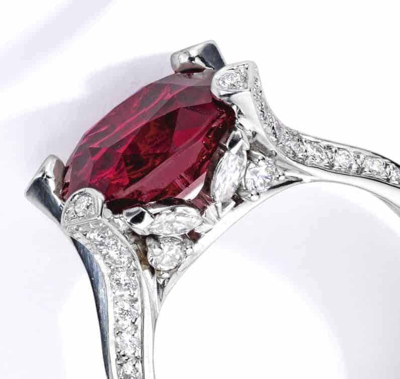 Lot 57 - Platinum, Ruby and Diamond Ring, Van Cleef & Arpels. Marquise and round-cut diamonds mounted as side stones are shown.