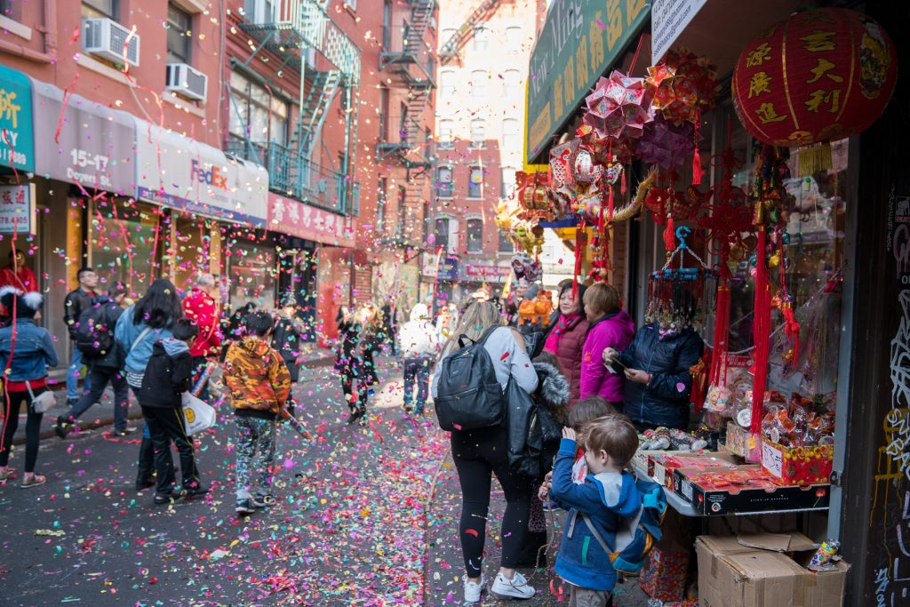 Things to do in NYC with Kids: Confetti in the streets of China Town