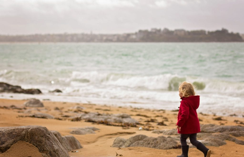 Saint-Malo Family Vacation: Little girl enjoying the beach