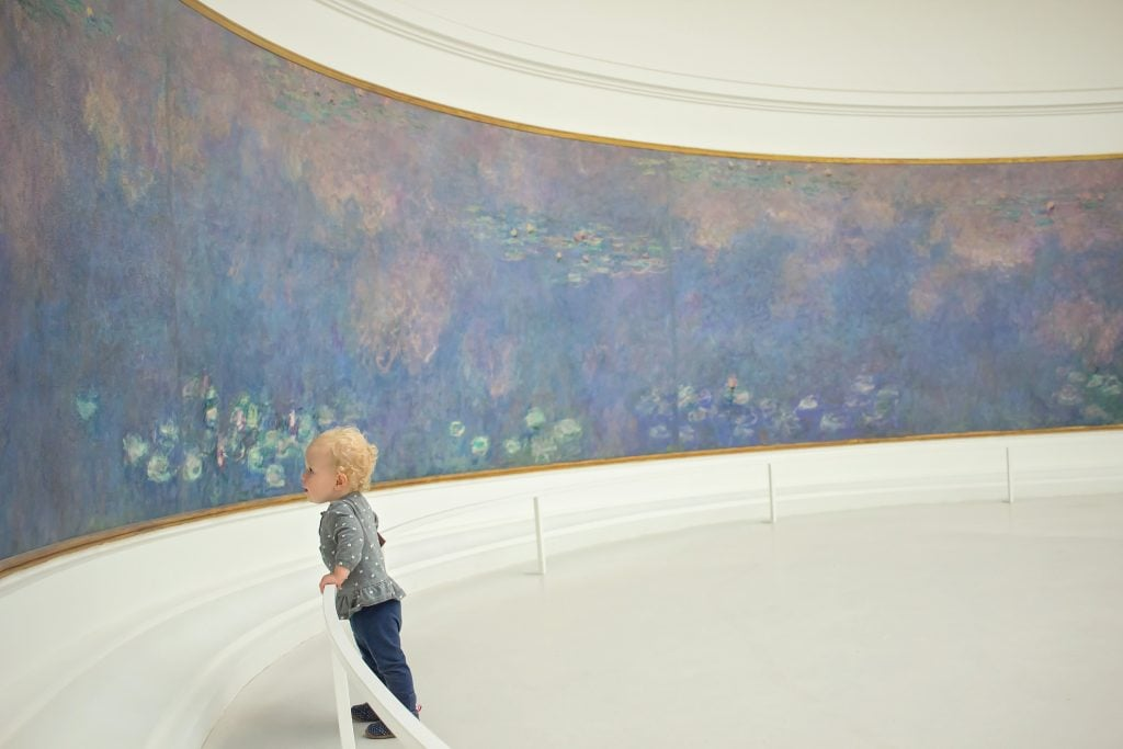 Paris with kids: A child viewing painting at Musée de l'Orangerie