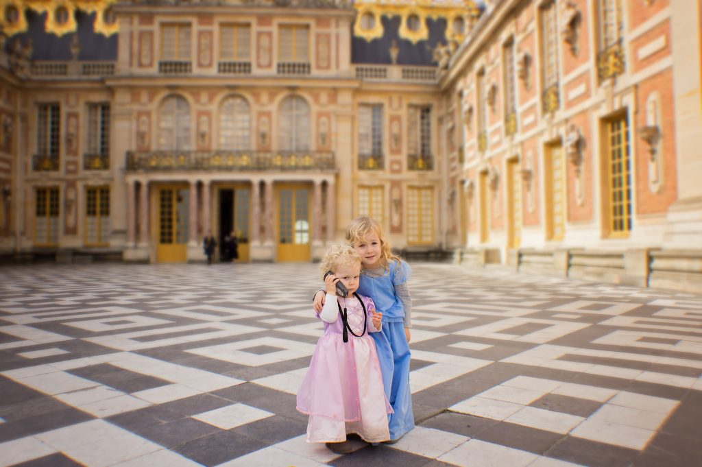 Two kids explore Versailles palace
