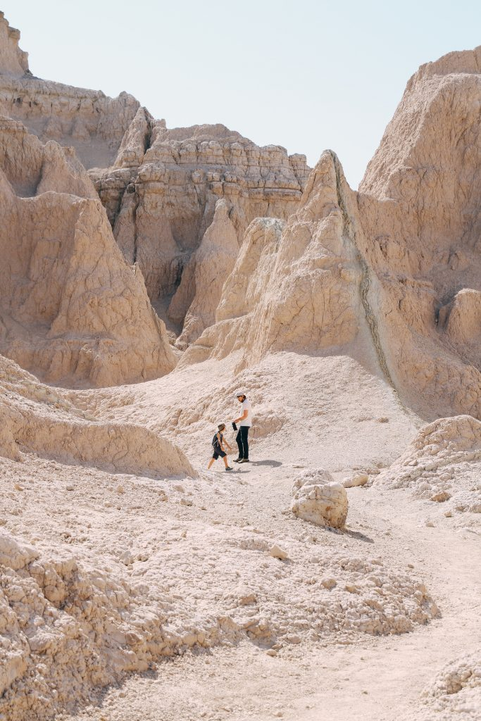 Father and son hiking in Badlands National Park